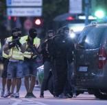 Miembros de las fuerzas especiales se preparan para registrar un barrio cercano al centro comercial Olympia en Mœnich, en el sur de Alemania, el 22 de julio de 2016, tras un tiroteo.  (AP Foto/Sebastian Widmann)