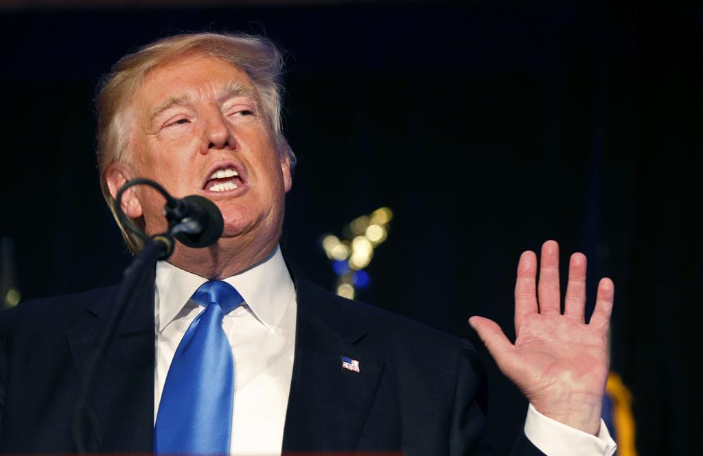 El candidato presidencial republicano Donald Trump habla en un acto de campa–a en Manchester, New Hampshire, el jueves 25 de agosto de 2016. (AP Foto/Gerald Herbert)