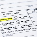 A form from the DMV suspending a driver's license.