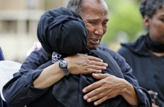 Mahmoud Hassanen Aboras, father of Nabra Hassanen, right, gets a hug from a supporter Wednesday, June 21, 2017, in Reston, Va., prior to the start of a vigil in honor of Nabar, who was killed over the weekend. Islamic leaders are questioning Virginia detectives' insistence that the beating death of Nabar appears to have been a case of road rage, saying the attack looks all too much like a hate crime. (AP Photo/Steve Helber)