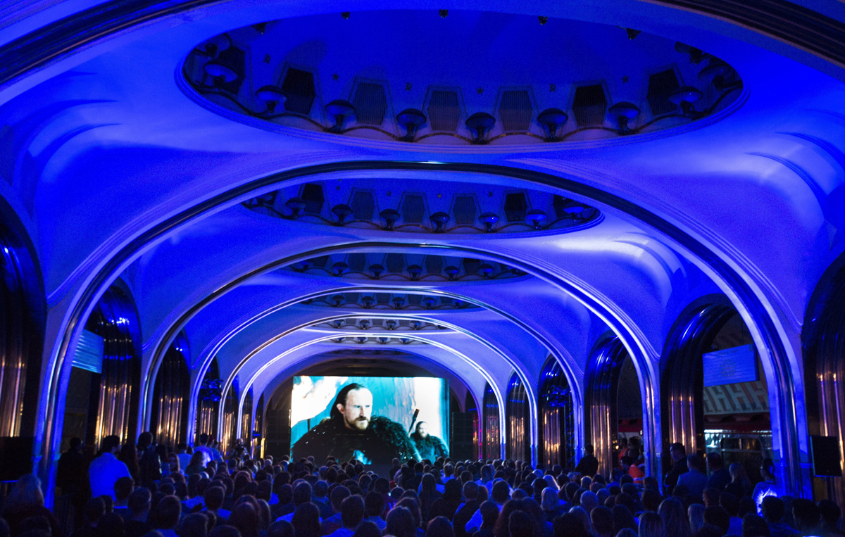 """Spectators watch the premiere of the """"Game of Thrones"""" television series, just one day after its premiere in the U.S. during the Night in the Metro at Mayakovskaya subway station in Moscow, Russia, early Tuesday, July 18, 2017. Night in Moscow's Metro is the cultural project which pass several times in a year during a night in Moscow's subway. (AP Photo/Alexander Zemlianichenko)"""