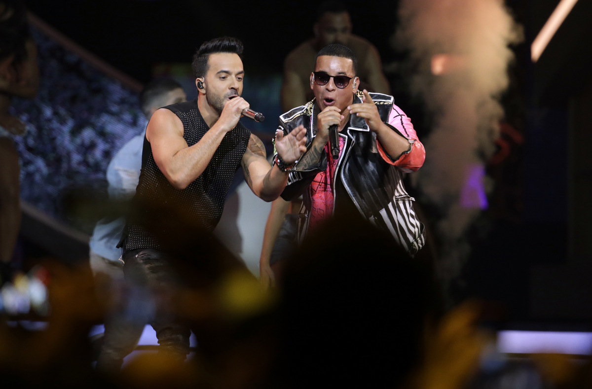 """FILE - In this April 27, 2017 file photo, singers Luis Fonsi, left and Daddy Yankee perform during the Latin Billboard Awards in Coral Gables, Fla. Universal Music Latin Entertainment announced Wednesday, July 19, 2017, that """"Despacito"""" has become the most streamed song of all time with more than 4.6 billion plays six months after its release. The song by Luis Fonsi and Daddy Yankee, and a companion remix featuring Justin Bieber, has surpassed the 4.38 billion plays recorded for the previous record holder, which was Bieber's hit """"Sorry."""" (AP Photo/Lynne Sladky, File)"""