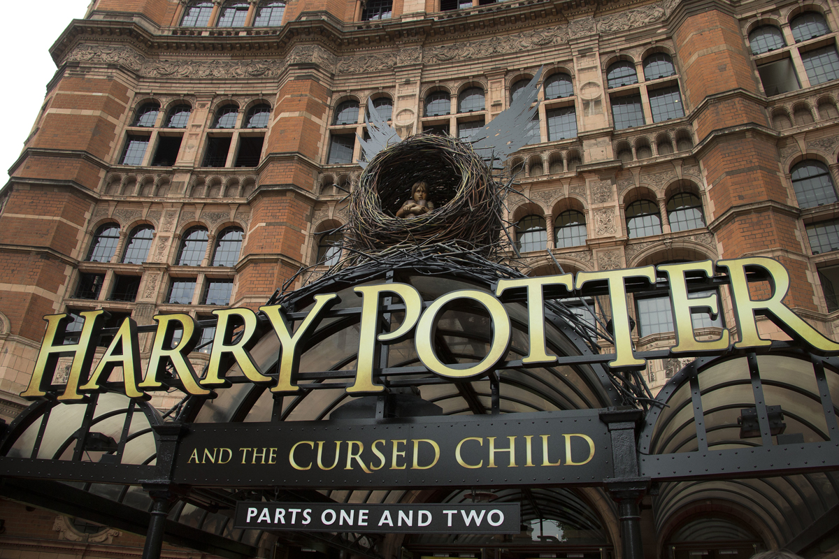 """FILE - This July 30, 2016, file photo shows the Palace Theatre in central London which is showing a stage production of, """"Harry Potter and the Cursed Child."""" Harry Potter publisher Bloomsbury announced July 18, 2017, that two new books from the Harry Potter universe are set to be released in October as part of a British exhibition that celebrates the 20th anniversary of the launch of the series. (Photo by Joel Ryan/Invision/AP, File)"""