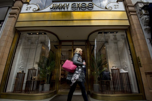FILE - This is a  April 24, 2017 file photo of  the Jimmy Choo shop on New Bond Street, London. American fashion brand Michael Kors has bought luxury shoemaker Jimmy Choo in a deal worth $1.35 billion (896 million pounds.) Kors said Tuesday July 25, 2017  the London-listed Jimmy Choo is