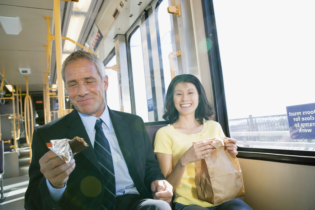 Businessman and woman commuting on subway