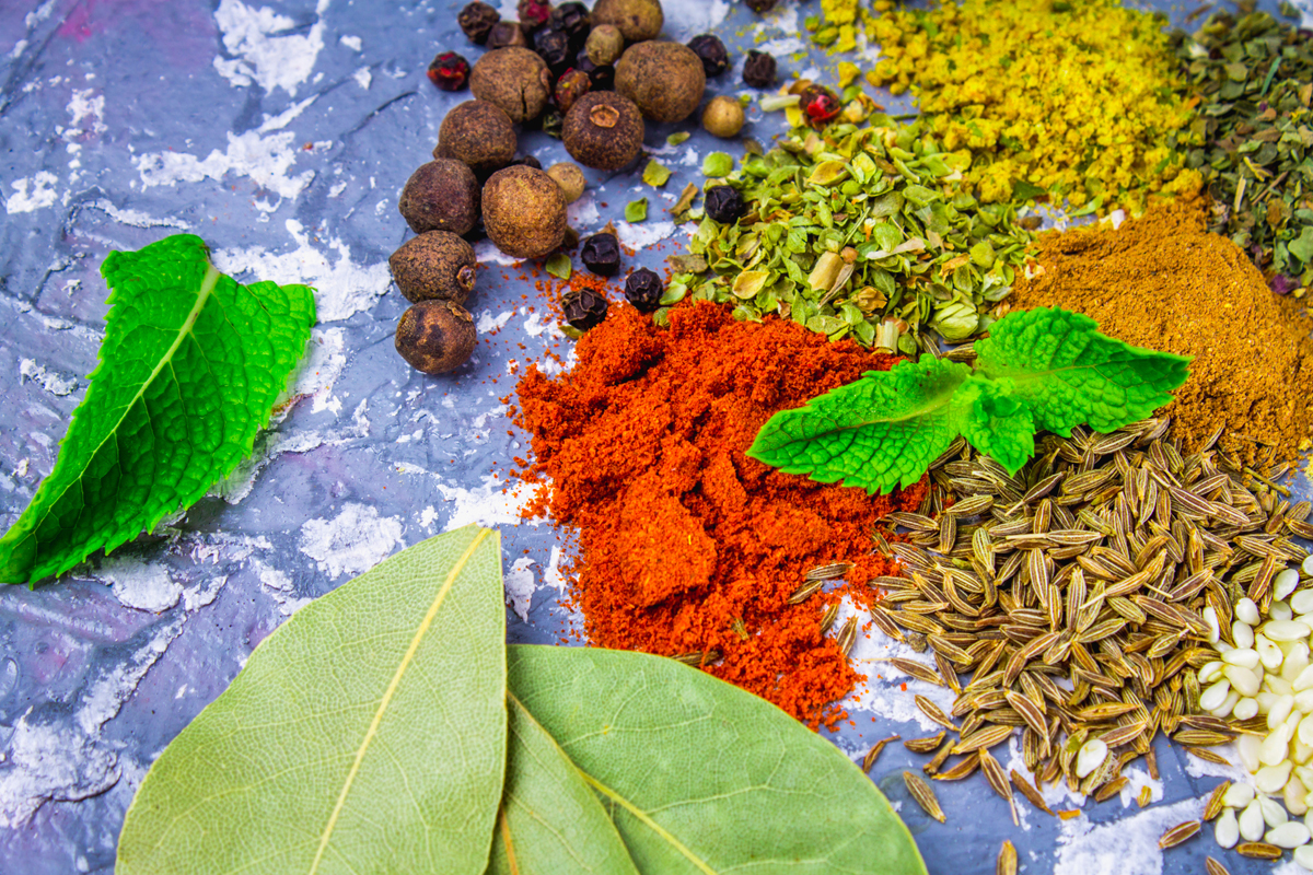 Spices and herbs on a black background