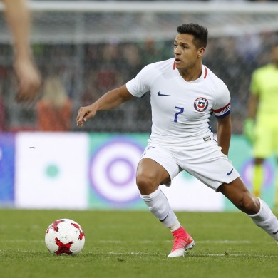 FILE - In this Friday, June 9, 2017 file photo, Chile's Alexis Sanchez during the international friendly soccer match between Russia and Chile at the VEB Arena stadium in Moscow.  Sanchez, who was Arsenal's leading scorer with 30 goals last season, may decide his future lies away from north London despite efforts from Arsene Wenger to hold onto him as Arsenal attempts to return to the Champions League. (AP Photo/Pavel Golovkin, FILE)