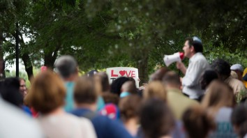 People attend a community gathering at Town Center Central Park in Virginia Beach, Va, Sunday, Aug, 13, 2017. Protesters decrying hatred and racism converged around the country on Sunday, saying they felt compelled to counteract the white supremacist rally that spiraled into deadly violence in Virginia. (L. Todd Spencer/The Virginian-Pilot via AP)