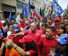 Diosdado Cabello, a member of the Constitutional Assembly and Venezuelan ruling party chief, center front, is surrounded by bodyguard and supporters during an anti-imperialist march to denounce Trump's talk of a
