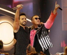 FILE - This April 27, 2017 file photo shows singers Luis Fonsi, left, and Daddy Yankee during the Latin Billboard Awards in Coral Gables, Fla. An MTV spokesperson said in a statement to The Associated Press on Monday, Aug. 14, 2017, that the ÔDespacitoÕ video was not submitted for consideration for nomination at the 2017 Video Music Awards. The hit songÕs video has not aired on MTV or MTV2, but is being played on MTV Tres, the companyÕs Latin channel. Universal Music Latin Entertainment, the label that released Luis Fonsi and Daddy YankeeÕs ÒDespacito,Ó said they welcome MTV to play Spanish videos on its main channel in a statement to the AP. (AP Photo/Lynne Sladky, File)