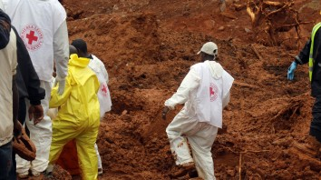 In this photo taken on Monday, Aug. 14, 2017 and provided by IFRC, Red Cross volunteers dig for survivors at the scene of heavy flooding and mudslides in Regent, just outside of Sierra Leone's capital Freetown. The Red Cross estimates that 600 people are still missing as the death toll from massive mudslides in Sierra Leone's capital is certain to rise. Authorities say more than 300 were killed in and around Freetown following heavy rains. Many victims were trapped under tons of mud as they slept. An official says the local mortuary is