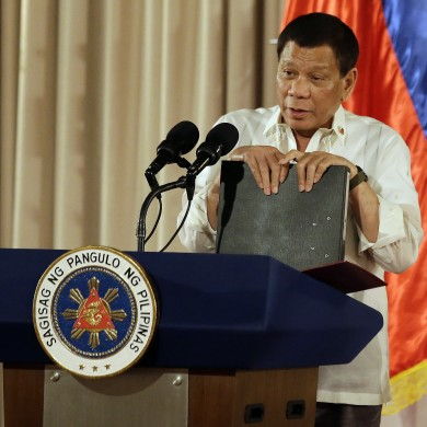 Philippine President Rodrigo Duterte holds documents containing a list of suspected drug dealers and users during the 19th Founding Anniversary of the Volunteers Against Crime and Corruption at the Malacanang Presidential Palace in Manila, Philippines on Wednesday, Aug. 16, 2017. (AP Photo/Aaron Favila)