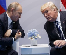 FILE - In this July 7, 2017 file photo, President Donald Trump meets with Russian President Vladimir Putin at the G20 Summit in Hamburg.  Putin is more trusted than Trump to do the right thing for the world among citizens of numerous U.S. allies, including Japan, South Korea and seven European NATO members, according to new survey released Wednesday, Aug. 16, 2017. (AP Photo/Evan Vucci, File)