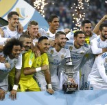 Real Madrid's players celebrate with their trophy after winning the Spanish Super Cup against Barcelona at the Santiago Bernabeu Stadium in Madrid, Thursday, Aug. 17, 2017. Real Madrid won 5-1 on aggregate. (AP Photo/Francisco Seco)