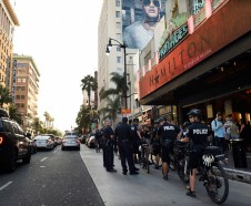 Police officers line up in front of the Pantages Theatre on Hollywood Boulevard on the opening night of the Los Angeles run of