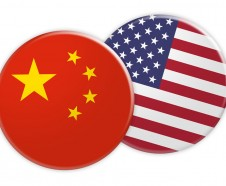 News Concept: China Flag Button On USA Flag Button, 3d illustration on white background