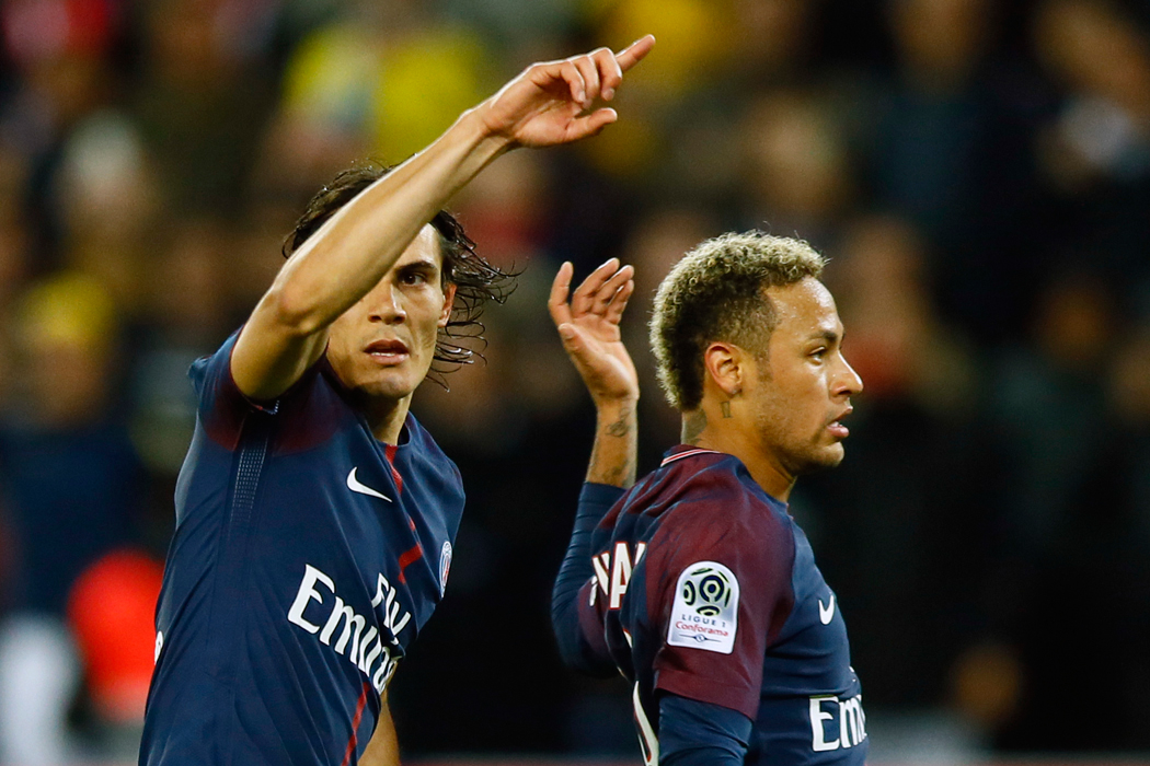 Paris Saint Germain's Edinson Cavani, left, flanked by Neymar, reacts after he missed a penalty kick during their French League One soccer match between PSG and Olympique Lyon at the Parc des Princes stadium in Paris, France, Sunday, Sept. 17, 2016. (AP Photo/Francois Mori)