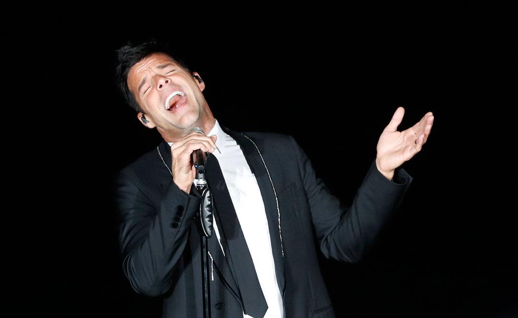FILE - In this July 7, 2017 file photo, Puerto Rico's Ricky Martin performs in concert at the Auditorio Nacional in Mexico City. Martin has postponed his concert Wednesday, Sept. 20, 2017, in Mexico City after an earthquake hit Mexico on Tuesday. (AP Photo/Eduardo Verdugo, File)