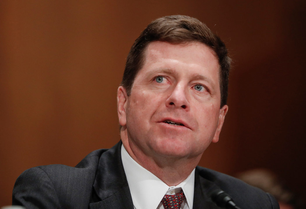FILE- In this March 23, 2017, file photo, Securities and Exchange Commission (SEC) Chairman nominee Jay Clayton testifies on Capitol Hill in Washington at his confirmation hearing before the Senate Banking Committee. The SEC says a cyber breach of a filing system it uses may have provided the basis for some illegal trading in 2016. In a statement posted Wednesday, Sept. 20, evening on the SECÕs website, Clayton says a review of the agencyÕs cybersecurity risk profile determined that the previously detected ÒincidentÓ was caused by Òa software vulnerabilityÓ in its EDGAR filing system. (AP Photo/Pablo Martinez Monsivais, File)