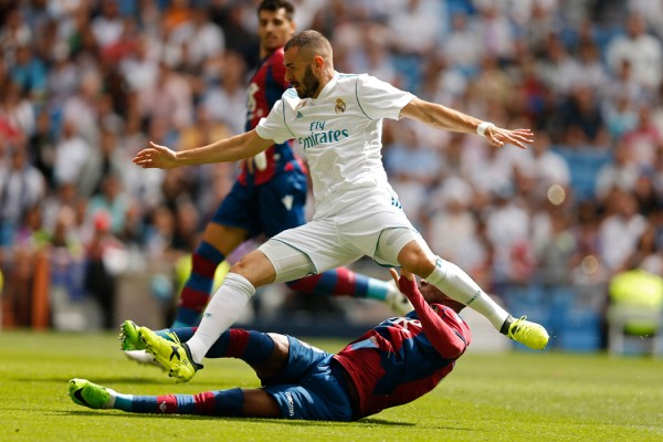 Real Madrid's Karim Benzema, top, is tackled by Levante's Jefferson Lerma during the Spanish La Liga soccer match between Real Madrid and Levante at the Santiago Bernabeu stadium in Madrid, Saturday, Sept. 9, 2017. The match ended in a 1-1 draw. (AP Photo/Francisco Seco)