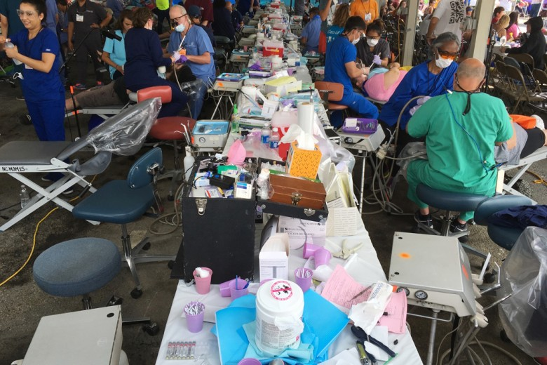 In this Friday, July 21, 2017 photo, a table of medical and dental supplies spans the length of the dental tent at the Remote Area Medical clinic in Wise, Va. The weekend clinic gave free medical and dental treatment to more than 2,000 low-income patients. (AP Photo/Dylan Lovan)