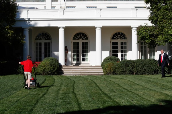 Frank Giaccio, 11, of Falls Church, Va., is surprised by President Donald Trump, right, Friday, Sept. 15, 2017, while mowing the lawn of the Rose Garden at the White House in Washington. The 11-year-old, who wrote the president requesting to mow the lawn at the White House, was so focused on the job at hand the he didn't notice the president until he was right next to him. (AP Photo/Jacquelyn Martin)