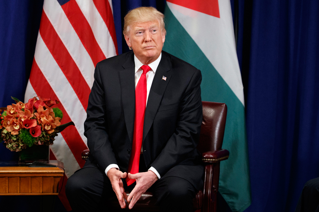 President Donald Trump listens during a meeting with Jordan's King Abdullah II at the Palace Hotel during the United Nations General Assembly, Wednesday, Sept. 20, 2017, in New York. (AP Photo/Evan Vucci)