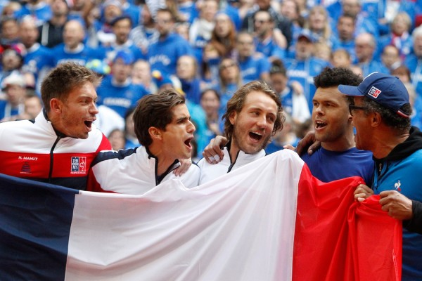 Jubilating French team, with from left, Nicolas Mahut, Pierre-Hugues Herbert, Lucas Pouille, Wilfried Tsonga and Captain Yannick Noah jubilates after winning the Davis Cup semi final against Serbia at the Pierre Mauroy stadium in Lille, northern France, Sunday, Sept.17, 2017. (AP Photo/Michel Spingler)