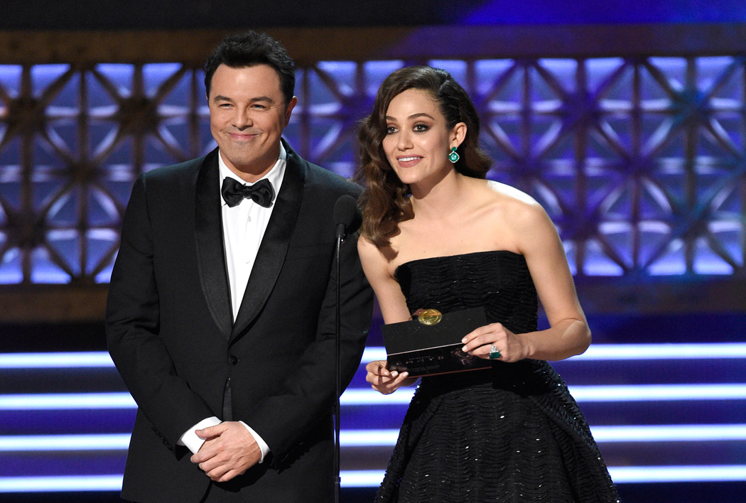 Seth MacFarlane, left, and Emmy Rossum present the award for outstanding writing for a limited series, movie or a dramatic special at the 69th Primetime Emmy Awards on Sunday, Sept. 17, 2017, at the Microsoft Theater in Los Angeles. (Photo by Chris Pizzello/Invision/AP)