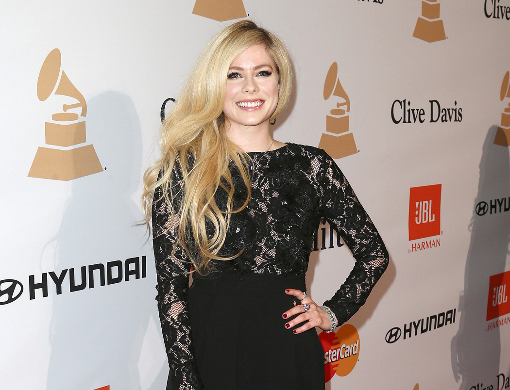 FILE - In this Feb. 14, 2016 file photo, Avril Lavigne arrives at the 2016 Clive Davis Pre-Grammy Gala in Beverly Hills, Calif. Cybersecurity firm McAfee said Tuesday, Sept. 19, 2017, that Lavigne, whose last album came out in 2013, was the most likely celebrity to land users on websites that carry viruses or malware. Searches for Lavigne have a 14.5 percent chance of landing on a web page with the potential for online threats, a number that increases to 22 percent if users type her name and search for free MP3s. (Photo by John Salangsang/Invision/AP, File)