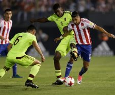 Venezuela's Sergio Cordova fights for the ball with Paraguay's Ceccilio Dominguez during a World Cup qualifying game, in Asuncion, Paraguay, Tuesday, Oct. 10, 2017. (AP Photo/Jorge Saenz)