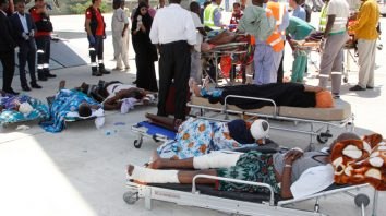 Critically wounded people wait to be moved into a waiting Turkish plane to be airlifted by air ambulance for treatment in Turkey, in Mogadishu, Somalia, Monday, Oct, 16, 2017. The death toll from Saturday's truck bombing in Somalia's capital now exceeds 300, the director of an ambulance service said Monday, as the country reeled from the deadliest single attack. (AP Photo/Farah Abdi Warsameh)