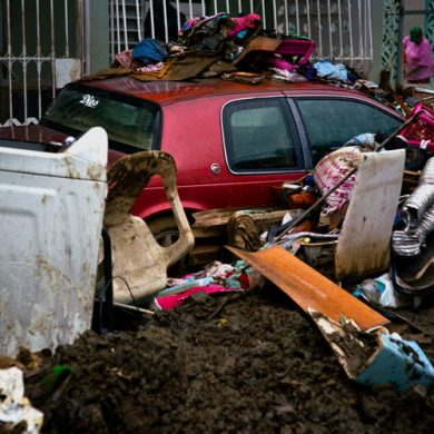 Items destroyed by flooding from Hurricane Maria sit in the street, waiting to be picked up by the garbage service, in Toa Baja, Puerto Rico, Monday, Oct. 16, 2017. With hundreds of thousands of people still without running water, and 20 of the islandÕs 51 sewage treatment plants out of service, there are growing concerns about contamination and disease. (AP Photo/Ramon Espinosa)