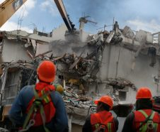 In this Oct. 17, 2017 photo, workers tear down an earthquake-damaged building at 1503 Concepcion Beistegui in the Narvarte neighborhood of Mexico City. Crews are stripping buildings of anything that could be a hazard and begin the slow process of low-tech demolition in an urban setting. (AP Photo/Marco Ugarte)
