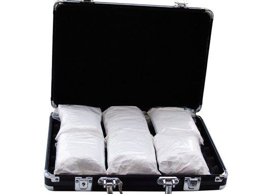 Cocaine in a suitcase (really it's powdered sugar).