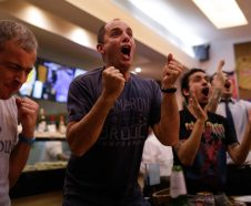 Soccer fans watch a 2018 World Cup qualifying match between Argentina and Ecuador, played in Quito, Ecuador, televised live at a bar in Buenos Aires, Argentina, Tuesday, Oct. 10, 2017. (AP Photo/Natacha Pisarenko)