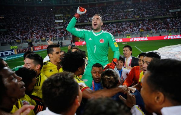 Colombia goalkeeper David Ospina celebrates with teammates after playing Peru to a 1-1 draw during a World Cup qualifying soccer match against Colombia in Lima, Peru, Tuesday, Oct. 10, 2017. (AP Photo/Rodrigo Abd)