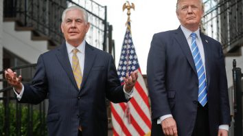 FILE - In this Aug. 11, 2017, file photo, Secretary of State Rex Tillerson, left, speaks following a meeting with President Donald Trump at Trump National Golf Club in Bedminster, N.J. Trump challenged Tillerson to Òcompare IQ tests,Ó delivering a sharp-edged ribbing that threw a bright spotlight on his seemingly shaky relationship with his top diplomat. The White House insisted he was only joking. (AP Photo/Pablo Martinez Monsivais, File)