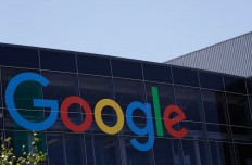 FILE - This Tuesday, July 19, 2016, file photo shows the Google logo at the company's headquarters in Mountain View, Calif.  Google says it is digging into its vaults for evidence of Russian meddling in the 2016 election, after Virginia Sen. Mark Warner slammed Twitter for a response to a congressional probe he called inadequate. The search giant said in a statement Friday, Sept. 29, 2017,  that it is cooperating with inquiries and is looking for how it can help with any relevant information. (AP Photo/Marcio Jose Sanchez, File)