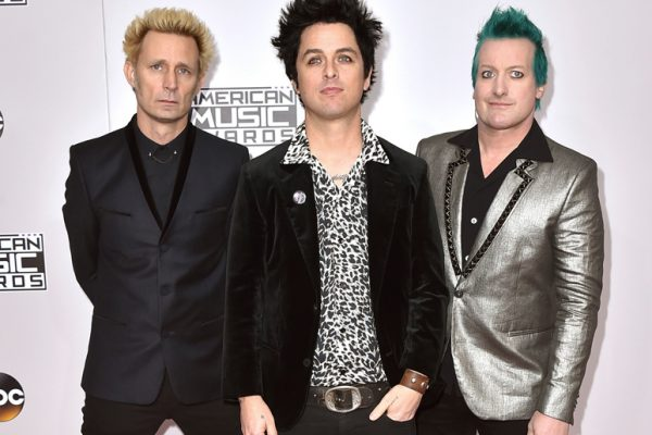 FILE - In this Nov. 20, 2016 file photo, Mike Dirnt, from left, Billie Joe Armstrong, and Tre Cool, of Green Day, arrive at the American Music Awards in Los Angeles. The band will release their latest, ÒGreatest Hits: God's Favorite Band,Ó on Friday. (Photo by Jordan Strauss/Invision/AP)