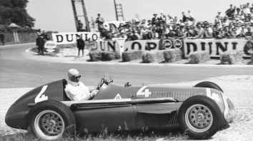 FILE - In this July 1, 1951 file photo Juan Manuel Fangio comes out of a bend at speed during the race, driving a supercharged 1.5 Liter Alfa Romeo during the Grand Prix D'Europe at Rheims, France. Alfa Romeo has joined up with the Sauber team for a return to Formula One after an absence of more than 30 years. Sauber announced Wednesday, Nov. 29, 2017 that it has reached a