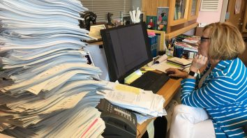 A pile of paperwork sits on the desk of Judge Marilyn Moores as she works in her office in Indianapolis on Aug. 3, 2017. From her first full year on the bench in 2006 through last year, the number of filings for children in need of services more than tripled to 4,649 in Marion County, driven largely by cases involving opioids _ a glimpse of a problem that has swept across communities of all sizes. (AP Photo/Matt Sedensky)
