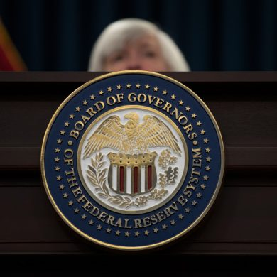 The seal of the Board of Governors of the United States Federal Reserve System is displayed on the desk as Federal Reserve Chair Janet Yellen speaks during a news conference following the Federal Open Market Committee meeting in Washington, Wednesday, Dec. 13, 2017. (AP Photo/Carolyn Kaster)