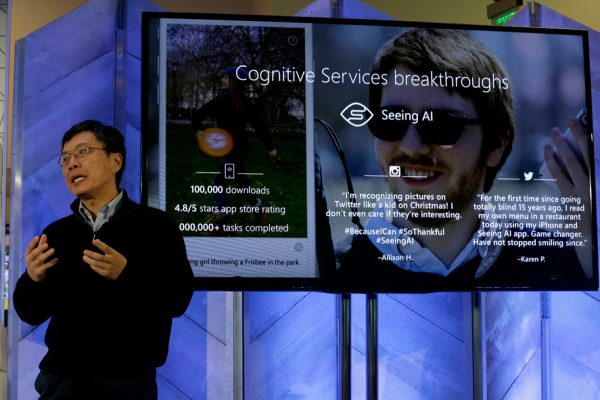 Harry Shum,Êexecutive vice president ofÊMicrosoft'sÊArtificial Intelligence and Research, speaks at a Microsoft event in San Francisco, Wednesday, Dec. 13, 2017. Microsoft on Wednesday rolled out new features on its Bing search engine powered by artificial intelligence, including one that summarizes the two opposing sides of contentious questions, and another that measures how many reputable sources are behind a given answer. (AP Photo/Jeff Chiu)