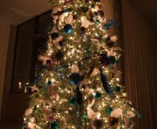 Christmas tree lit with fairylights and decorated with baubles