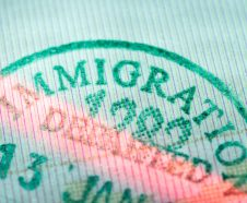 closeup fragment of immigration departed stamp scanned by laser beam
