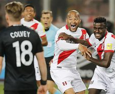 Peru's Christian Ramos, right,. celebrates after scoring his side's second goal against New Zealand, with his teammate Alberto Rodriguez , center, during a play-off qualifying match for the 2018 Russian World Cup in Lima, Peru, Wednesday, Nov. 15, 2017.  Peru won the match 2-0 and qualified for the World Cup for the first time in 36 years. (AP Photo/Karel Navarro)