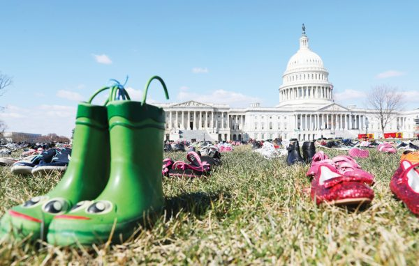 7000 pairs of shoes, one for every child killed by gun violence since the Sandy Hook school shooting, were placed on the Capitol lawn by Avaaz, a U.S.-based civic organization, on Capitol Hill in Washington, Tuesday, March 13, 2018. (AP Photo/Pablo Martinez Monsivais)