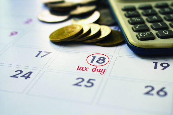 calendar of tax day on 18 April 2017,deadline note tax day wording on calendar.
