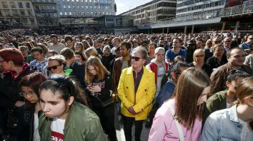 Fans of Dj Avicii gather for a minute's silence in his honour, at Sergels Torg in central Stockholm, Sweden, Saturday, April 21, 2018. Avicii, the Grammy-nominated electronic dance DJ who performed sold-out concerts for feverish fans around the world and also had massive success on U.S. pop radio, died Friday. He was 28. (Fredrik Persson/TT New Agency via AP)